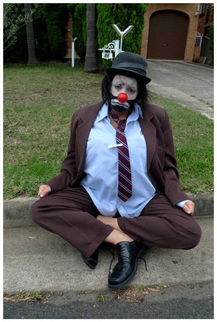 emmett-kelly-sad-clown-costume-sitting-gutter